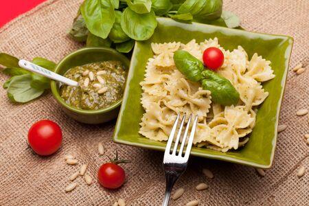overhead shot: Farfalle With Pesto - Overhead shot of Italian pasta garnished with pesto sauce