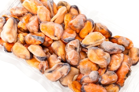 food preservation: Food Preservation - Package of frozen mussels on white background  Stock Photo