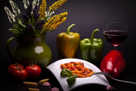 Still life of typical Italian cuisine - Penne Rigate Con Peperoni  Penne With Peppers   photo