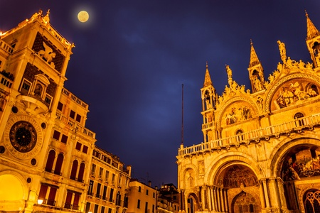 Full moon in San Marco Square with view of San Marco Basilica and the Clock Tower, Venice, Italy photo