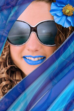 Concept of summer fashion and trends - Portrait of woman with blue accessories and makeup. photo