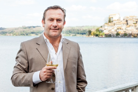 Photo of man relaxing with a glass of white wine in hand. Stock Photo - 19423777