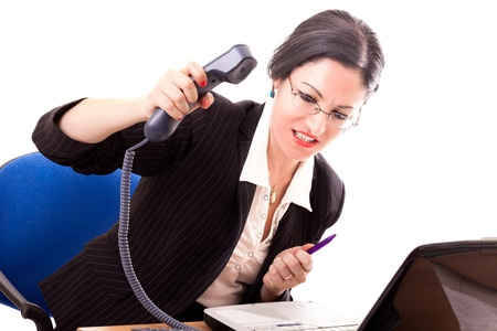 Stressed businesswoman hanging up the phone to someone