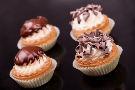 ornated: Cupcakes ornated with chocolate glaze and chips.
