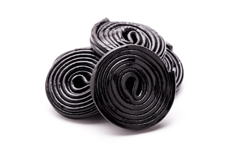 Licorice wheels on white background.