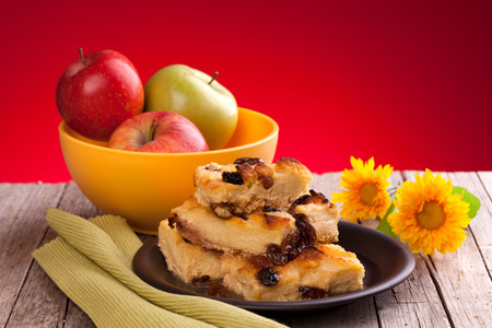 Apples and English bread and butter pudding  photo