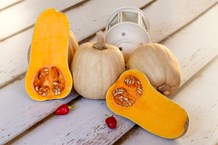 Still life with butternut squash and chili peppers  photo