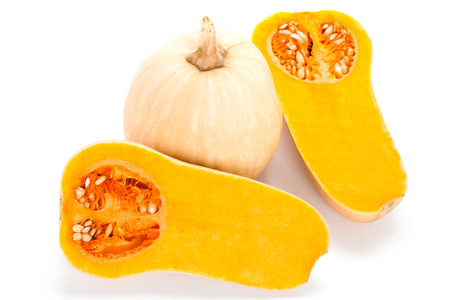 Butternut squash whole and cut on white background
