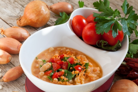 Bowl with mashed Cannellini beans soup. photo