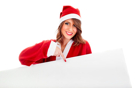 Sexy young Santa Claus woman holding white customizable billboard. photo