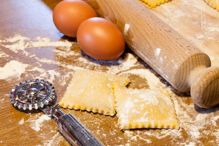 Fresh handmade agnolotti, typical Italian egg pasta from Piedmont, Langhe and Monferrato.