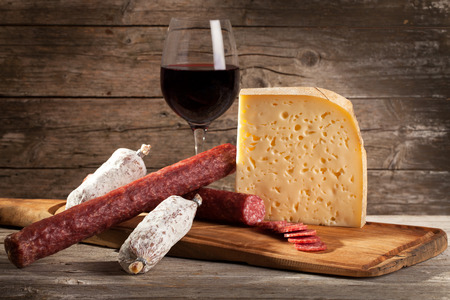 Italian cheese and salami with glass of red wine. photo