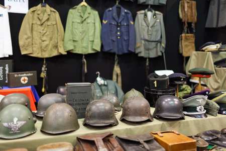 ROME, ITALY - FEBRUARY 16, 2014: At Fiera di Roma, military clothing, helmets and other accessories are displayed for sale on the occasion of Rome Military And Soft-Air Exhibition.