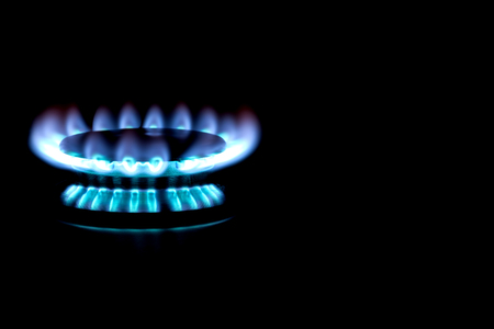 Natural gas burning with blue flame  - stove burner on black background  photo