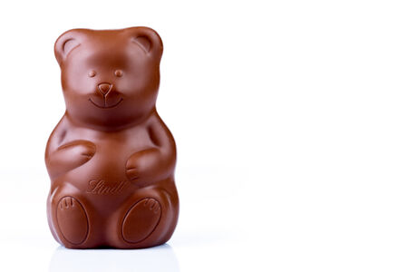 lindt: ROME, ITALY - FEBRUARY 25, 2014  Photo of a Lindt Milk Chocolate Bear, product that is part of the hollow bodies of Lindt chocolate which makes 32  to 54  of the Italian market share on Easter and Christmas