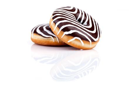 Chocolate zebra donuts with dark and white chocolate cream, over white background. Stock Photo