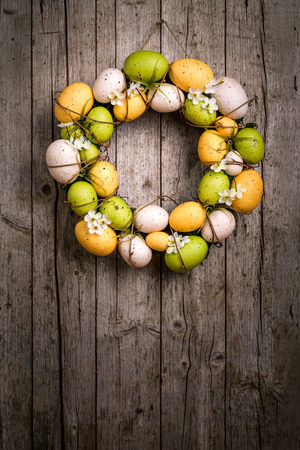 Easter wreath from eggs and spring flowers appended. Stock Photo