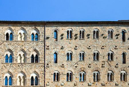 priori: Detail of Palazzo Pretorio facade in Piazza dei Priori, Volterra, Tuscany, Italy. Stock Photo