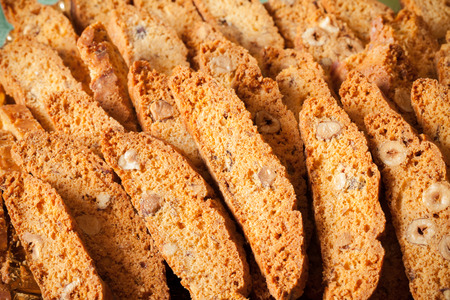 Tozzetti are traditionally Italian oblong-shaped almond biscuits, made dry and crunchy through cutting the loaf of dough while still hot and fresh from baking in the oven.