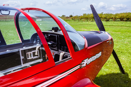 SUTRI, LAZIO, ITALY - APRIL 6, 2014: Detail of red Pioneer 300 Hawk  ultralight aircraft at La Valicella airfield. The Pioneer 300 Hawk is an Italian ultralight and light-sport aircraft, designed and produced by Alpi Aviation, of Pordenone. The aircraft i