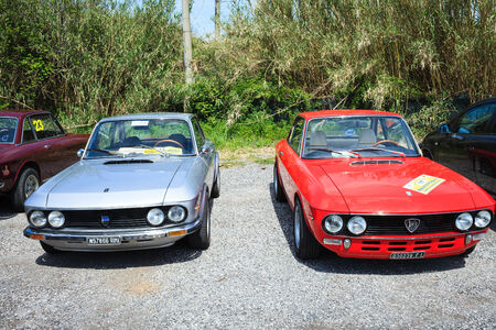 ANGUILLARA SABAZIA, LAZIO, ITALY - APRIL 6, 2014: Red and silver vintage Lancia Fulvia cars, participating at the 11-th meeting of spring memorial Luciano Polverari. Fulvias are notable for their role in automobile racing history, including winning the In