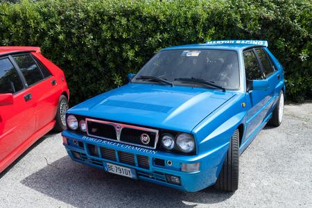 hf: ANGUILLARA SABAZIA, LAZIO, ITALY - APRIL 6, 2014: Blue  Lancia Delta HF Integral Martini Racing participating at the 11-th meeting of spring memorial Luciano Polverari.  Editorial