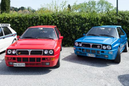 ANGUILLARA SABAZIA, LAZIO, ITALY - APRIL 6, 2014: Blue, red and white Lancia Delta HF Integral Martini Racing cars participating at the 11-th meeting of spring memorial Luciano Polverari.