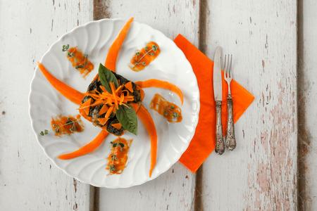 overhead shot: Overhead shot of plate with pumpkin based recipe: pumpkin gnocchi with chard and pumpkin cream.