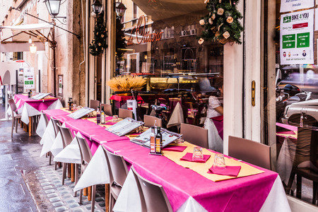 eat right: ROME, ITALY - JUNE 18, 2014: Restaurant Da Ottavio, the right place to take a break and eat something in the center of Rome, just a few steps from Piazza Navona.