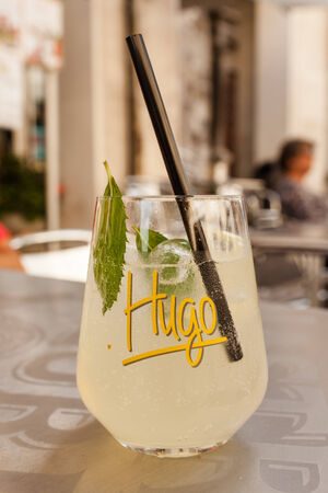 SULMONA, ITALY - JULY 5, 2014  Glass with Hugo cocktail, drink with lime and mint in sparkling wine  It was created in 2005 by the barman Naturnser Roland Gruber as an alternative to spritz