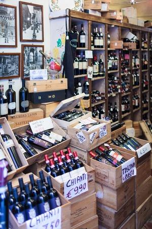 SIENA, ITALAY - MARCH 14, 2014: Chianti wine in sale in a wine shop. A Chianti wine is any wine produced in the Chianti region, in central Tuscany.