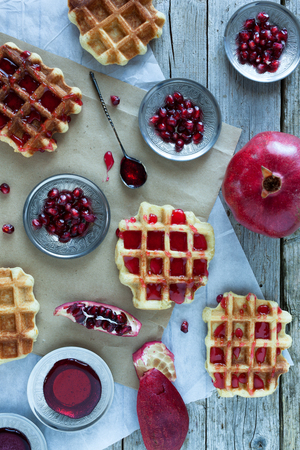 Crisp golden fresh baked waffle topped with pomegranate sorbet. photo