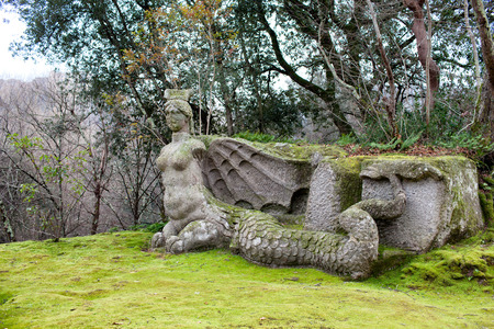 underworld: Statue representing the mythical figure of Fury, a demon of the underworld in the popular primitive beliefs. The Park Of Monsters, Bomarzo, Italy. Stock Photo