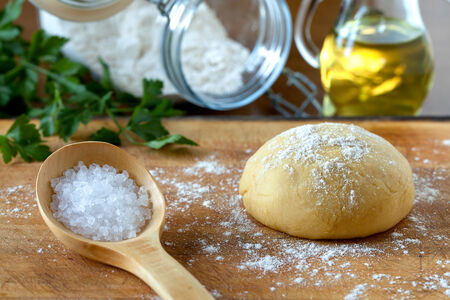 extra virgin olive oil: Ingredients for dough of homemade pasta: flour, salt and extra virgin olive oil. Stock Photo