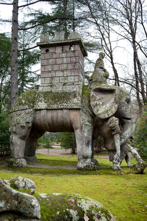 surmounted: Elephant statue surmounted by a tower, which crushes with his proboscis a Legionnaire.  The statue makes reference to Hannibal and his battles against Rome. Bomarzo, Italy.