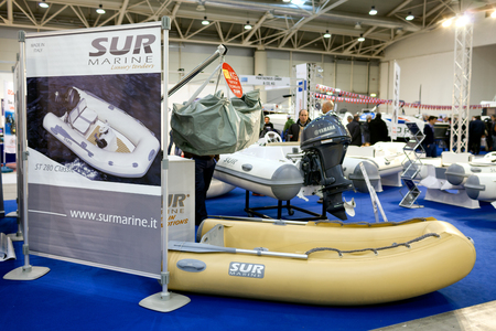 motorboats: ROME, ITALY - FEBRUARY 26, 2015: Boat Show Rome 2015 edition, focused on small sized marine products, sailboats, motorboats, RIBs and inflatables up to 15 mt.  Sur Marine Stand