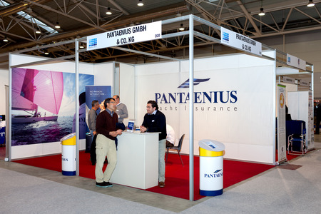motorboats: ROME, ITALY - FEBRUARY 26, 2015: Boat Show Rome 2015 edition, focused on small sized marine products, sailboats, motorboats, RIBs and inflatables up to 15 mt.  Pantaenius Yacht Insurance stand.