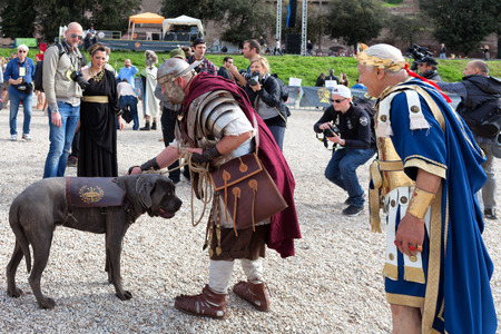 ROME, ITALY - APRIL 19, 2015: Birth of Rome festival - Actors dressed as ancient Roman soldiers attend a parade to commemorate the 2,768th anniversary of the founding of Rome. Editorial