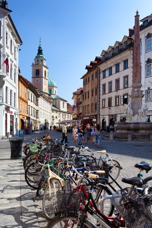 peddle: LJUBLJANA, SLOVENIA - AUGUST 31, 2015: Bicycles docking station. Public transport in Ljubljana is supplemented by urban cycling in the self-service bike borrowing system.