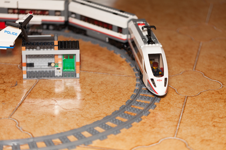 highspeed: ROME, ITALY - DECEMBER 28, 2015: The building toy from LEGO City, the high-speed passenger train. Lego is a popular line of construction toys manufactured by the Lego Group.