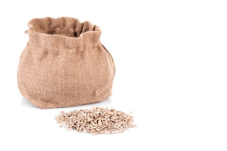 shelled: Small sack with shelled sunflower seeds, isolated on white background.