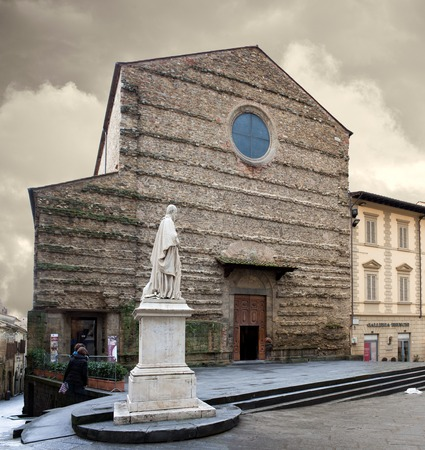 mathematician: AREZZO, ITALY - JANUARY 9, 2016: Front view of St. Francis Basilica and the statue of the italian statesman, mathematician, economist and engineer Vittorio Fossombroni. Editorial