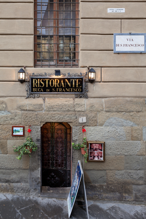 unforgettable: AREZZO, ITALY - JANUARY 9, 2016: Buca di S. Francesco restaurant. This place with a tiny door down tiny stairs is the gateway to an unforgettable tuscan food experience.