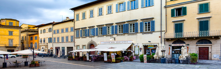 st  francis: AREZZO, ITALY - JANUARY 9, 2016: The St Francis Square with Caffe Dei Costanti. This cafe is famous in Arezzo as it is where the film Life is Beautiful was shot amongst other places around the town. Editorial