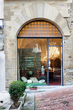AREZZO, ITALY - JANUARY 9, 2016: Window of Paolo Burzis antiquities shop in Corso Italia 22 selling mainly Tuscan art, all dating back from the 17th to the 19th Century.