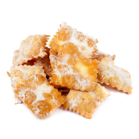 chiacchiere: Chiacchiere, italian traditional fried pastry with icing sugar prepared in carnival period. Photographed on white background.