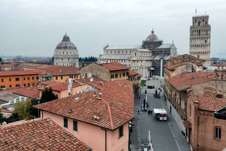 leaning tower of pisa: PISA, ITALY - JANUARY 23, 2016: View from above of road leading to the Dome Square with its morning activities and tourists visiting the leaning tower.