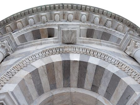 ancient architecture: White and grey marble arch, architectural detail of the Leaning Tower in Pisa, Italy.