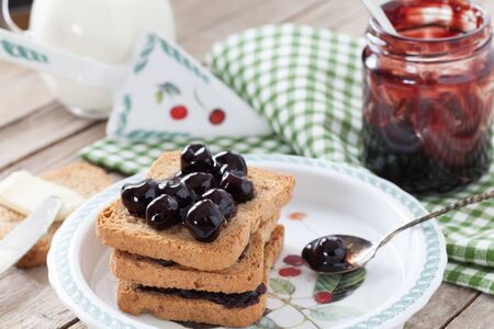 preserve: Breakfast with rusks and sour cherries jam. Stock Photo