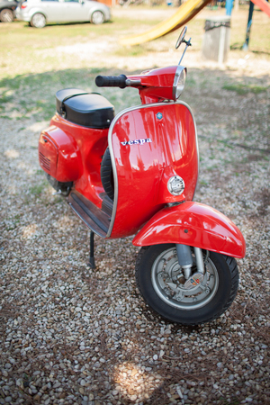 evolved: SANTA MARINELLA, LAZIO, ITALY - SEPTEMBER 28, 2014: Red vintage 50s Vespa Scooter, iconic symbol of Italy, manufactured by Piaggio. The Vespa has evolved from a single model motor scooter manufactured in 1946 by Piaggio & Co. S.p.A. of Pontedera, Italy-to